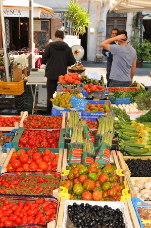 Rome, Italy - 28 March, 2012: Fresh fruits and vegetables  for sale in Campo de' Fiori, famous outdoor market in central Rome