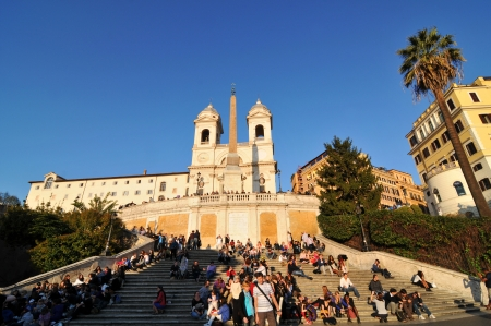 Rome, Italy - 30 March, 2012: Tourists enjoying the sunset in Piazza di Spagna, Rome