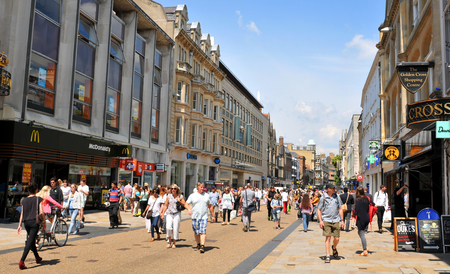 OXFORD, UK - JULY 9, 2014: Tourists in the city centre of Oxford, Oxfordshire - England