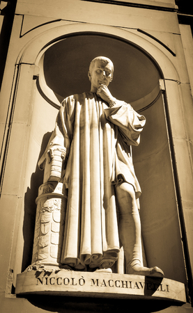 Architectural detail of statue depicting Niccolo Macchiavelli in Florence, Italy.