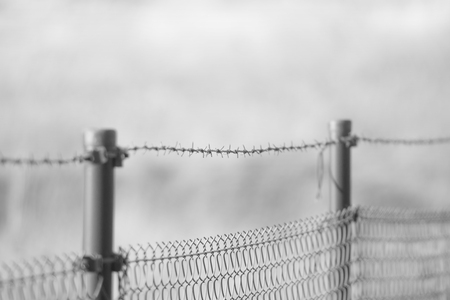 barbed wire over the fence