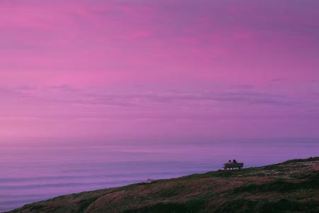 romantic view of couple watching beautiful sunset