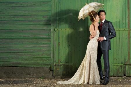 Foto de Handomse man with beautiful bride, wearing vintage wedding dress outdoors. - Imagen libre de derechos