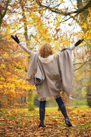 Foto de Middle aged woman celebrating happiness with open arms. - Imagen libre de derechos