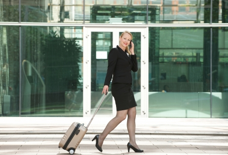 Portrait of a businesswoman traveling and calling with mobile phone