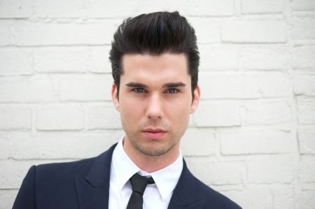 Closeup portrait of an attractive young man in business suit