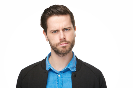 Close up portrait of a young man with a confused, thinking face