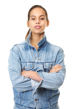 Close up portrait of a beautiful young woman standing on isolated white background with blue denim jeans jacket