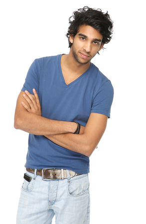 Close up portrait of a casual young man standing with arms crossed against isolated white background