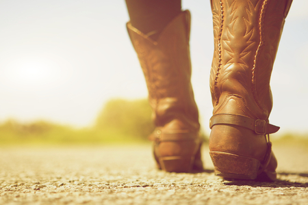 Close up low angle female with cowboy boots