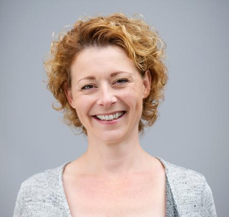 Foto für Close up portrait of a beautiful woman smiling on gray background - Lizenzfreies Bild