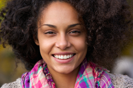 Close up portrait of a beautiful african american woman face smilingの写真素材