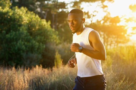 Photo pour Portrait of a sporty young man running outdoors in nature - image libre de droit