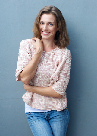Photo pour Portrait of a cheerful mid adult woman smiling in jeans and sweater - image libre de droit