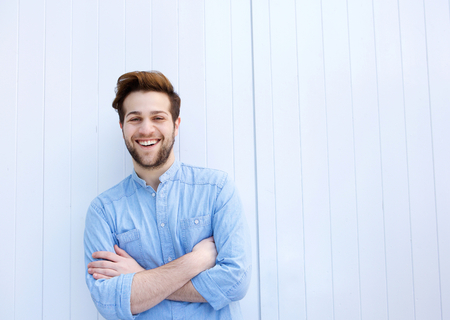 Photo for Portrait of an attractive young man smiling with arms crossed - Royalty Free Image