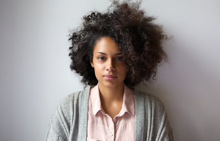 Close up portrait of a beautiful young woman with afro hairstyleの写真素材
