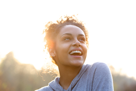 Photo for Portrait of an attractive young woman laughing and looking up - Royalty Free Image
