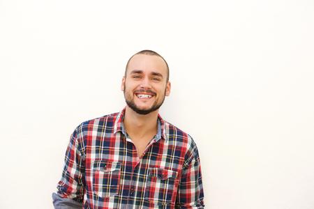 Photo pour Close up happy hispanic guy in plaid shirt smiling against white background - image libre de droit