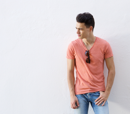 Portrait of a male fashion model posing against white background