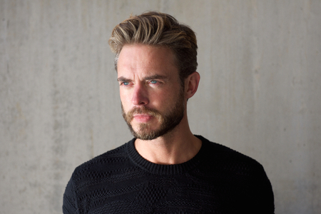 Photo for Close up horizontal portrait of a male fashion model with beard staring - Royalty Free Image