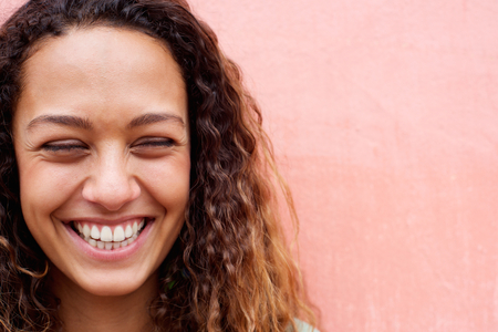 Photo for Close up portrait of laughing young woman with curly hair - Royalty Free Image
