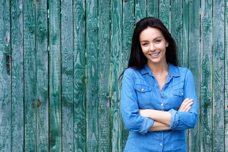 Photo for Portrait of a confident woman smiling with arms crossed - Royalty Free Image