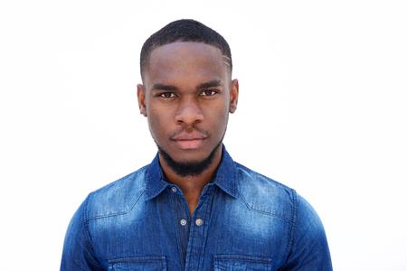 Foto de Close up portrait of an attractive young african american man on white background - Imagen libre de derechos