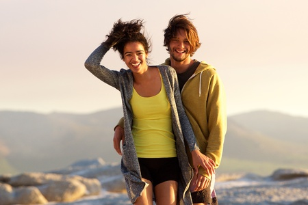 Photo for Portrait of a handsome young man and smiling woman outdoors - Royalty Free Image