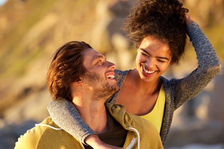 Photo for Close up portrait of an attractive couple laughing together - Royalty Free Image