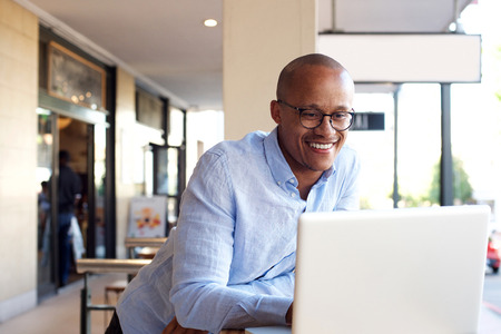 Photo for Portrait of handsome african businessman working with laptop - Royalty Free Image