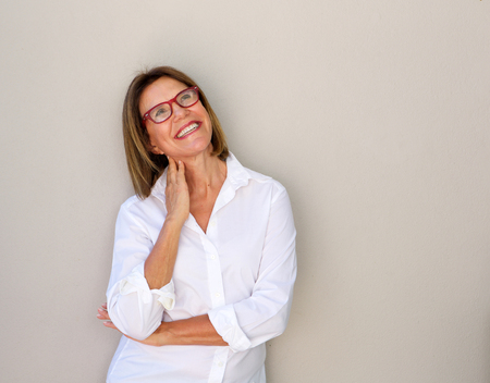 Photo for Portrait of smiling business woman with glasses looking up - Royalty Free Image