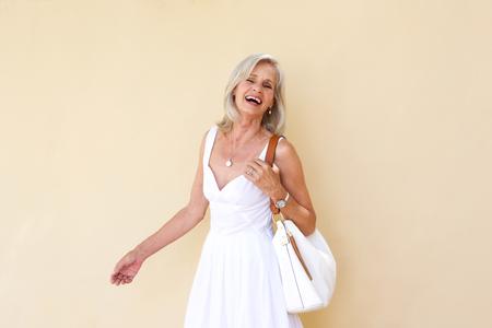 Foto für Portrait of cheerful older woman in summer dress - Lizenzfreies Bild