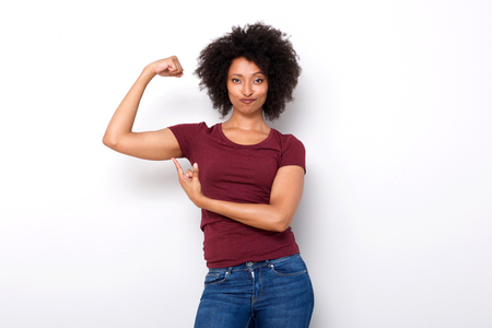 Photo for Portrait of fit young african woman pointing at arm muscles on white background - Royalty Free Image