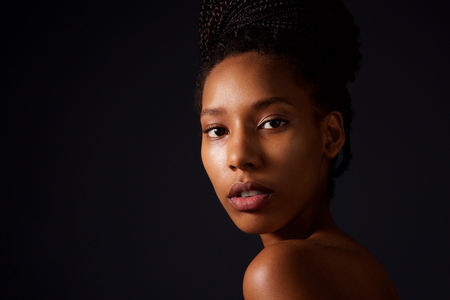 Close up beauty portrait of african american fashion woman against dark background