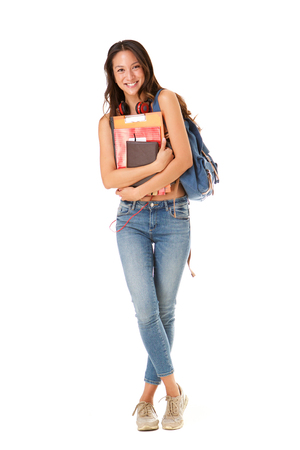 Foto de Full length portrait of smiling asian college student against isolated white background - Imagen libre de derechos