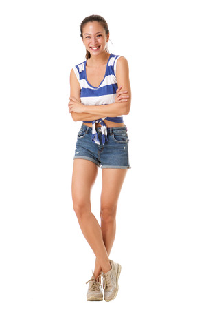 Full body portrait of beautiful young asian woman smiling shorts against isolated white background