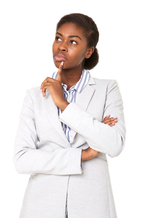 Photo pour Portrait of young african american woman thinking with hand to chin - image libre de droit