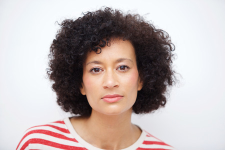 Foto für Close up front portrait of and older african american woman against white wall - Lizenzfreies Bild