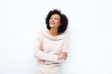 Foto de Portrait of middle age woman smiling with arms crossed against white background - Imagen libre de derechos