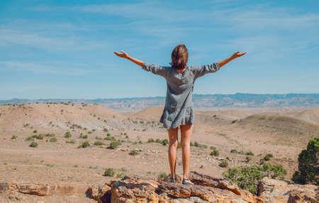 Photo pour Woman in a desert. Travel and adventure. - image libre de droit