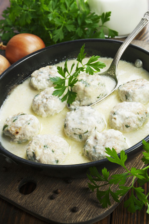 Photo pour Chicken meatballs in milk sauce on the table - image libre de droit