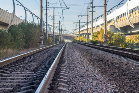 urban railway track with confusing lines and overhead cables