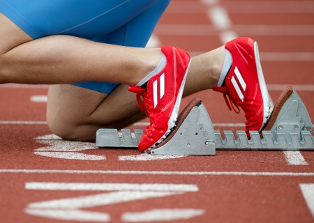 Detailed view of a sprinter in the starting blocks