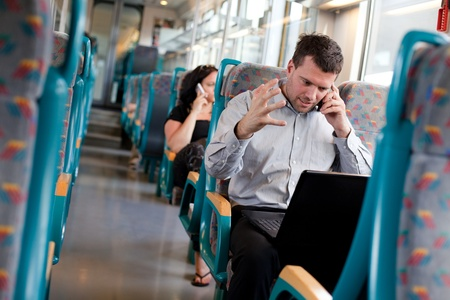Businessman receiving bad news on a train