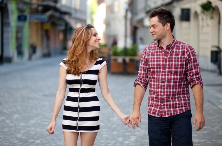 Young couple walking in the old part of town
