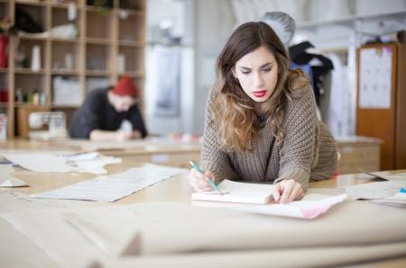 Fashion designers working in the studio