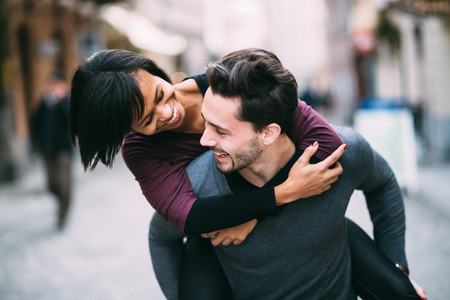 Interracial couple in love having fun in the city