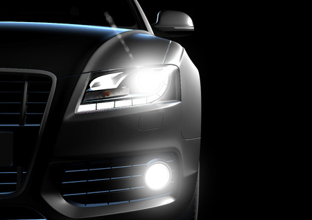Front view of luxury car in a black background