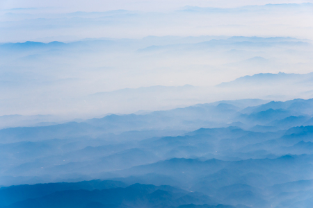 Photo pour 10,000 meters high altitude aerial view of the mountains and the sea of clouds - image libre de droit