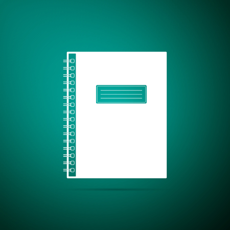 Notebook icon isolated on green background  Spiral notepad